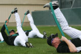 (826) Pitcher Aaron Cook stretches at Colorado Rockies spring training in Tucson, AZ, on Sunday,...