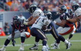 (DENVER, COLO., SEPTEMBER 26, 2004) - Denver Broncos' #59. Donnie Spragan and #68, Mario Fatafehi...
