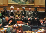 Members of the President's Day Society are given a round of applause as the House and Senate held...