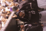 The Colorado Rockies' Garrett Atkins is congratulated by teammates after being batted in by Jeff...