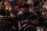 Colorado Rockies relief pitcher Matt Herges is congratulated by teammates after he got the team...
