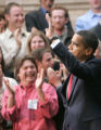 193 President Barack Obama waves to a friendly crowd before signing the $787 billion economic...