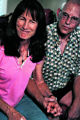 Joanne James, 56 sits beside her boyfriend Dennis Christensen, 58, while speaking about being...