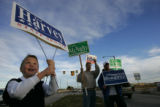 Jack Harvey, 9, son of Colorado state Representative Ted Harvey, holds a sign for his dad,  who's...
