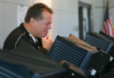 "Gene Brown, of Denver, contemplates his vote while using the new ""Edge"" voting machine..."
