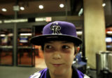 Patrick Barder, 11, of Littleton, Colorado, proudly wears his Colorado Rockies hat while waiting...