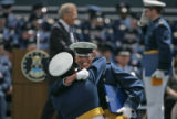 A graduating member of the 2006 graduating class of cadets at the Air Force Academy is embraced by...