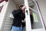 Adan Heter, left, and his father Phil Heter inspect and photograph a foreclosed home at 1725 W...
