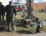 CBI Agent Jerry Means (cq) works his dog Sadie at a fire scene at Buckingham Gardens, 820 S....