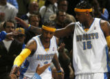 [ JOE0432 ] Denver Nuggets Allen Iverson, left, and Carmelo Anthony are congratulated in the...