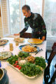 Laura Merage arranges food on the table at her home in the Denver area for Sabbath dinner on March...