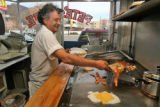 Pete Gatseos (cq) prepares food at his restaurant, Pete's Cafe,  on  514 East Colfax Avenue Monday...