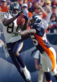 (DENVER, COLO., SEPTEMBER 26, 2004) - San Diego Chargers #81, Kassim Osgood, left, pulls down a...