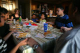 The Fox family sits down for dinner, holds hands and says a prayer. This night Lanae, 4, (cq),...