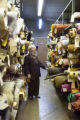 Store owner, Anna Woneis (CQ) of Denver stands between the tall shelves stacked with vintage...