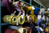 Rolls of vintage fabric are stocked on shelves at the American Fabric Company. EDS visits the...