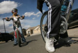 MJM333  Caitlyn Paxton (cq), 10, prepares to ride her bike with her mother, Victoria Paxton (cq)...