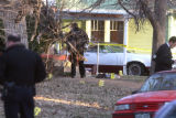 Denver police investigate the scene of a deadly shooing outside a home in the 1300 block of N....