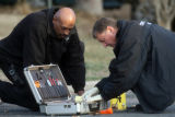 Denver police get fingerprints from a magazine at the scene of a deadly shooing outside a home in...