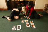 Donna Baldwin, right and Diana Gormley (cq), an agent in Donna's office, pick out photos for a...