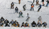 Cowboys stampede down the race course at the Bud Light Cowboy Downhill, Tuesday afternoon, January...