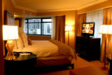 Bedroom in the Luxury Suite Thursday morning, March 27, 2008, Denver. The Ritz Carlton has the...