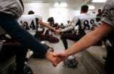 (DENVER, Co., SHOT 9/30/2004) Silver Creek High School football players gather together joining...