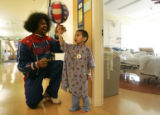 """Wildkat"" Edgerson, of the Harlem Globetrotters, shows Brian Cordova (cq), 6, of..."