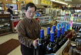 Sam Lee (cq), in his FanFare Liquor store, 475 Havana, Tuesday afternoon, March 11, 2008, Aurora. ...