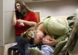 24 year-old Kinzie Cuba (cq) of littleton kisses her 7 month-old son Quentin Cuba (cq), as her...