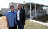 PHOTO BY CHRISTOPHER TOMLINSON--Loa Richards, left and her daughter Donna DeKruger in front of...