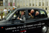 Denver, Colo. Denver Mayor, John Hickenlooper is in the driver's seat of a London Taxi that is...