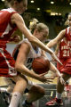 024 (5A) Highlands Ranch Falcons' #15 Taylor Johnson, right, struggles with Regis Jesuit Raiders'...