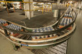 Cans go whizzing along at the bottling canning room  at  Coors Brewing Company in Golden,...