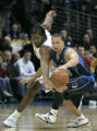 Nene tries to steal the ball from Tyronn Lue in the second half of the Denver Nuggets against the...