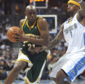 Seattle SuperSonic #21 Damien Wilkins (cq) tries to get by Nugget # 1 J. R. Smith (cq) during...