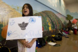 "DM0573   ""Si se puede"" chants fourth grader Renni Caparachini, 10, as she and other..."