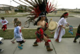 DM0172   Omar Morales, a dancer with the Tlaloc Aztec Dance Group leads hundreds of students from...