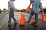(LONGMONT, Colo., September 28, 2004) Longmont Power Workers put out cones on the roadway. (a...