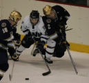 [ JOE0264 ]   University of New Hampshire left wing Greg Collins (8) scoops the puck from Notre...