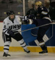 [ JOE0397 ]  University of New Hampshire Greg Collins (8) pushes Notre Dame right defenseman Craig...