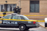 Boulder Police  and SWAT stand outside Boulder Community Hospital   Monday March 17,2008 in...