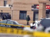Boulder SPolice  and Bomb Squad  enter the Boulder Community Hospital   Monday March 17,2008. A...