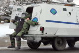 Boulder Police and Bomb Squad  enter the Boulder Community Hospital   Monday March 17,2008. A man...