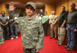 Ethan Moyer, 9, of Emporia, KS., is sworn into the Army at the Military Entrance Processing...
