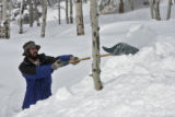 Curt Caywood (cq) clears snow from his driveway, Forest Estates Road, in Evergreen, Monday...