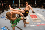 Kenny Florian, right, kicks Dokonjonosuke Mishima in an Ultimate Fighting Championship event on...