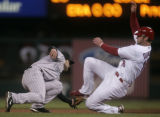 Jason Nix tags out Chris Duncan on a steal attempt in the 4th inning of the Colorado Rockies...