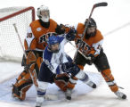 Air Force forward Josh Frider (11) tries to hold his place in front of  RIT goalie Louis Menard...