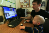 "DM0268   Master Sgt. Jeff ""J.T."" Theiral and his two-year-old son Jarret talk with..."
